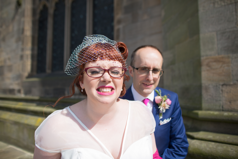 Bride grinning at camera