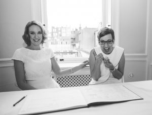 Two brides excited after signing wedding register