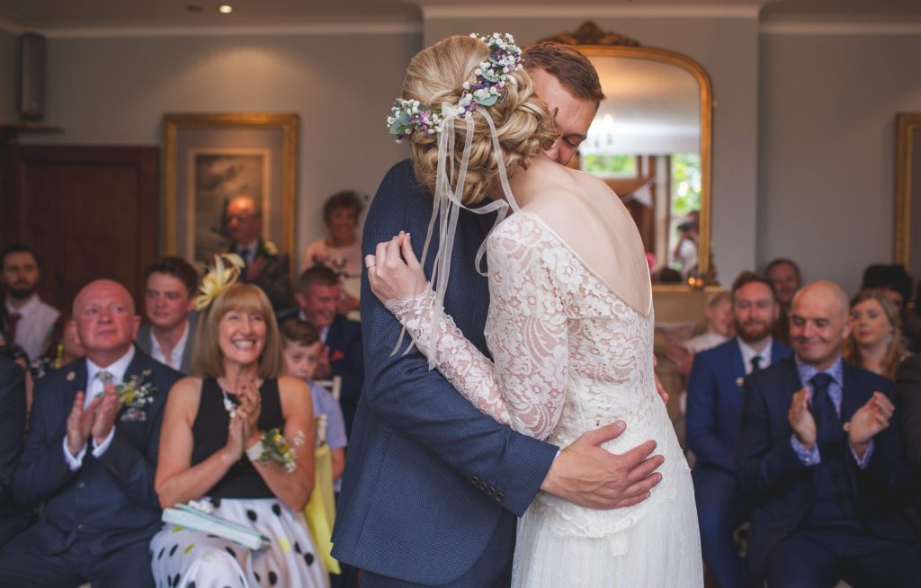 bride and groom hug during ceremony
