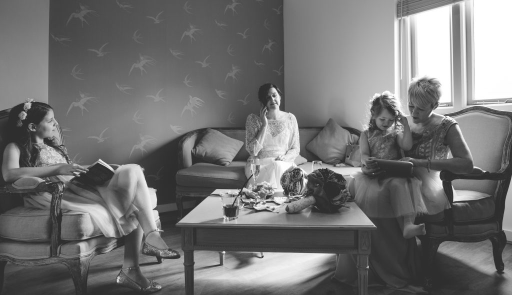 black and white photo of bridal party waiting before ceremony