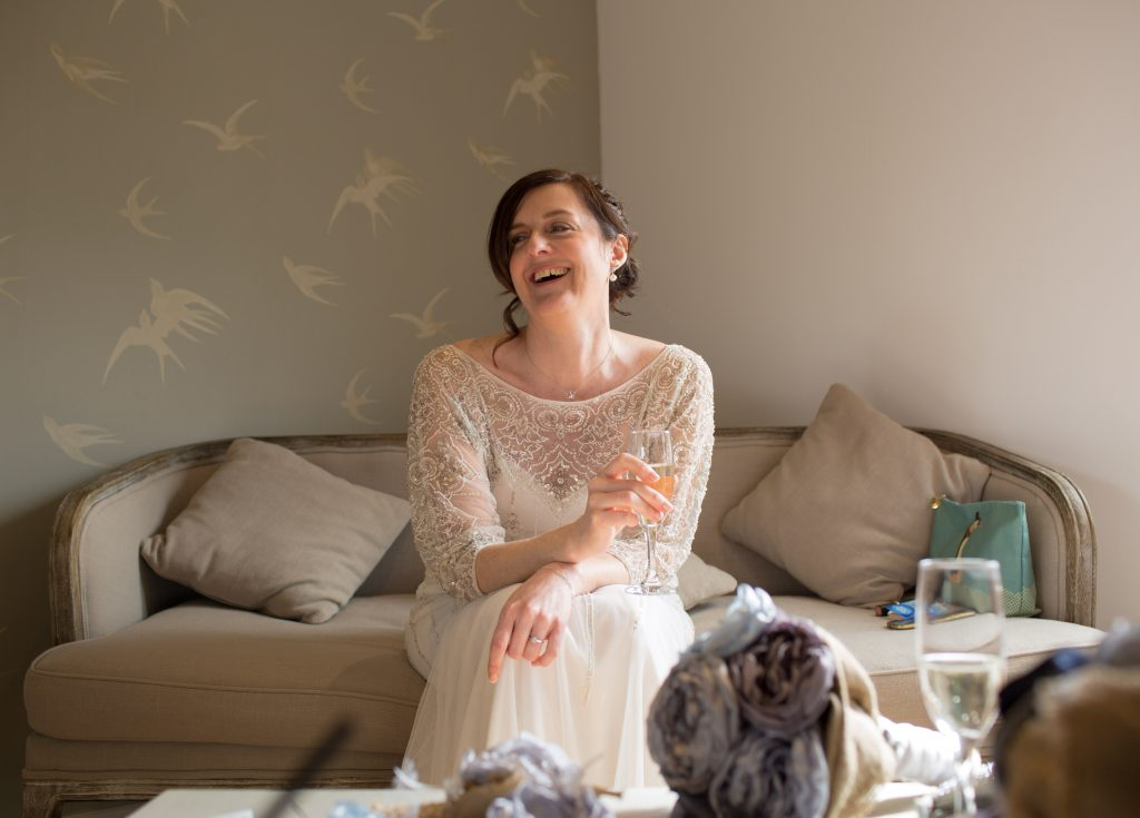relaxed bride laughing before ceremony