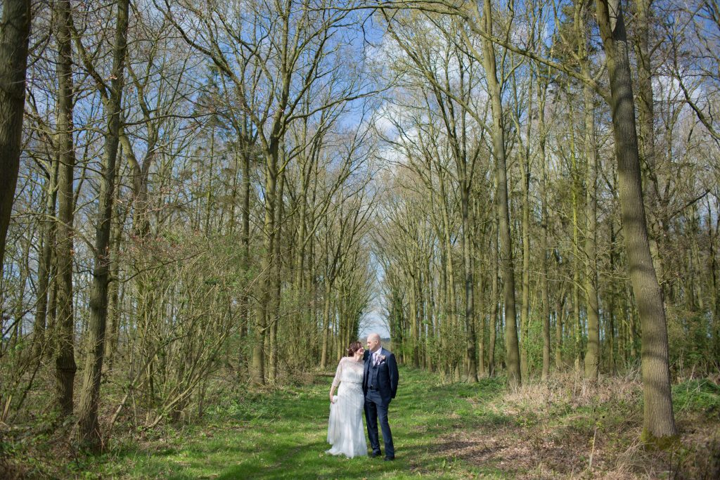 bride and groom stood in trees