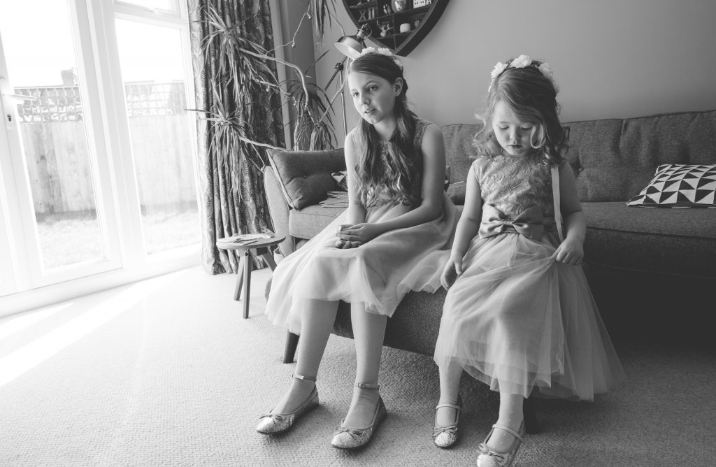 black and white photo of flower girls