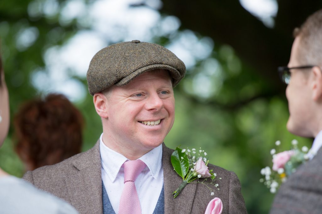 photo of best man smiling