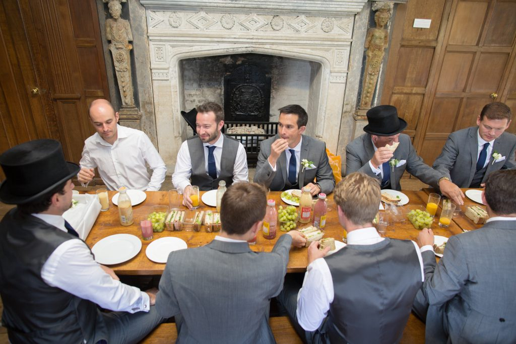 groom with ushers having lunch before wedding