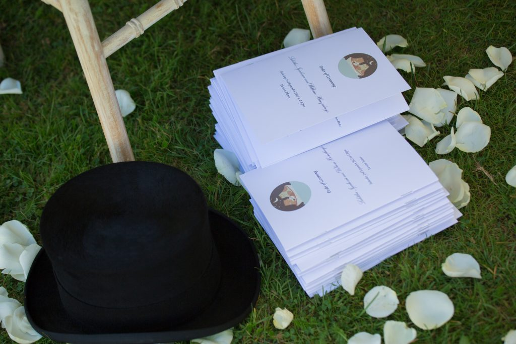 order of service next to top hat