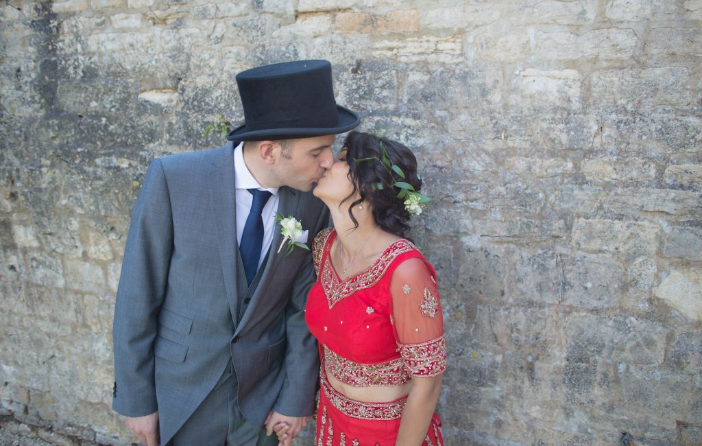 close up of a bride and groom kissing