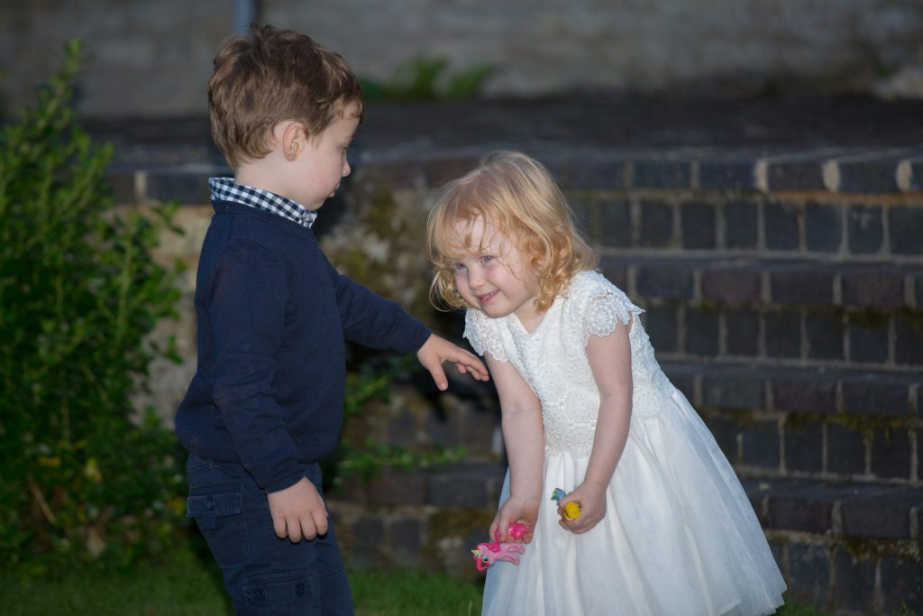 two children playing together at wedding