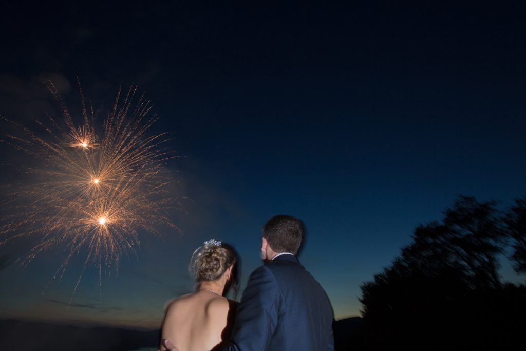 husband and wife watching fireworks