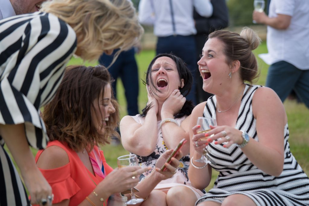 group of wedding guests laughing