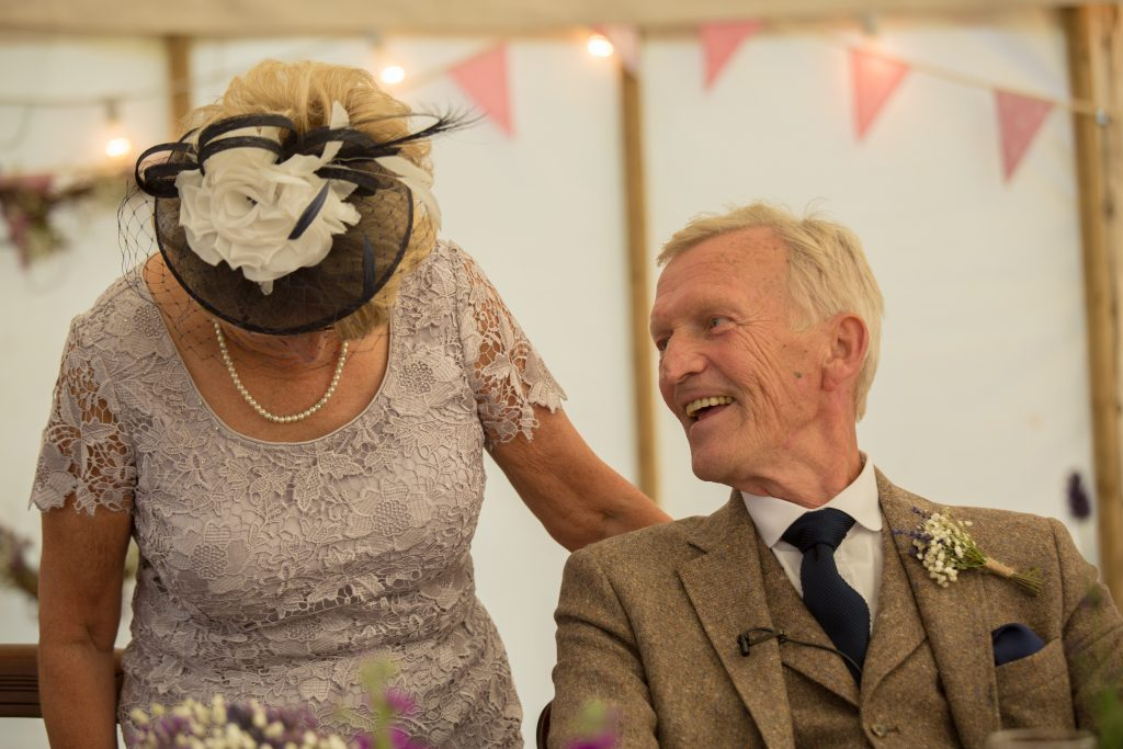 brides mum and dad laughing