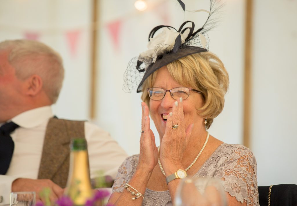 brides mum laughing and clapping