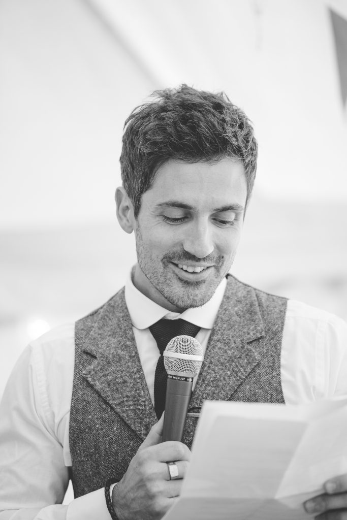 black and white photo of best man doing wedding speech