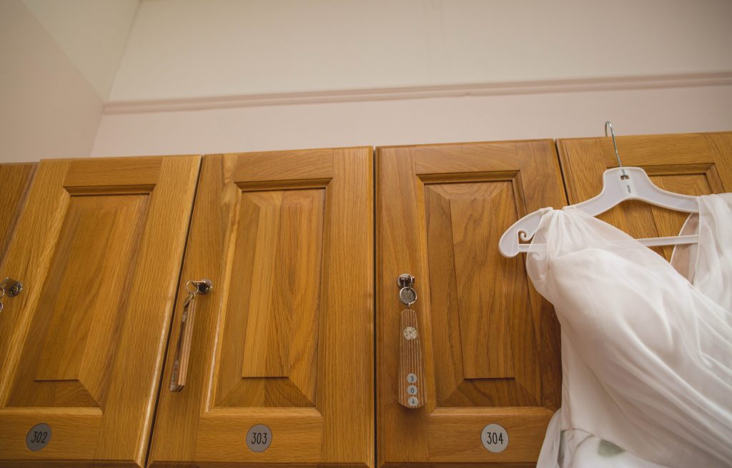 wedding dress hanging from lockers at Brocton hall