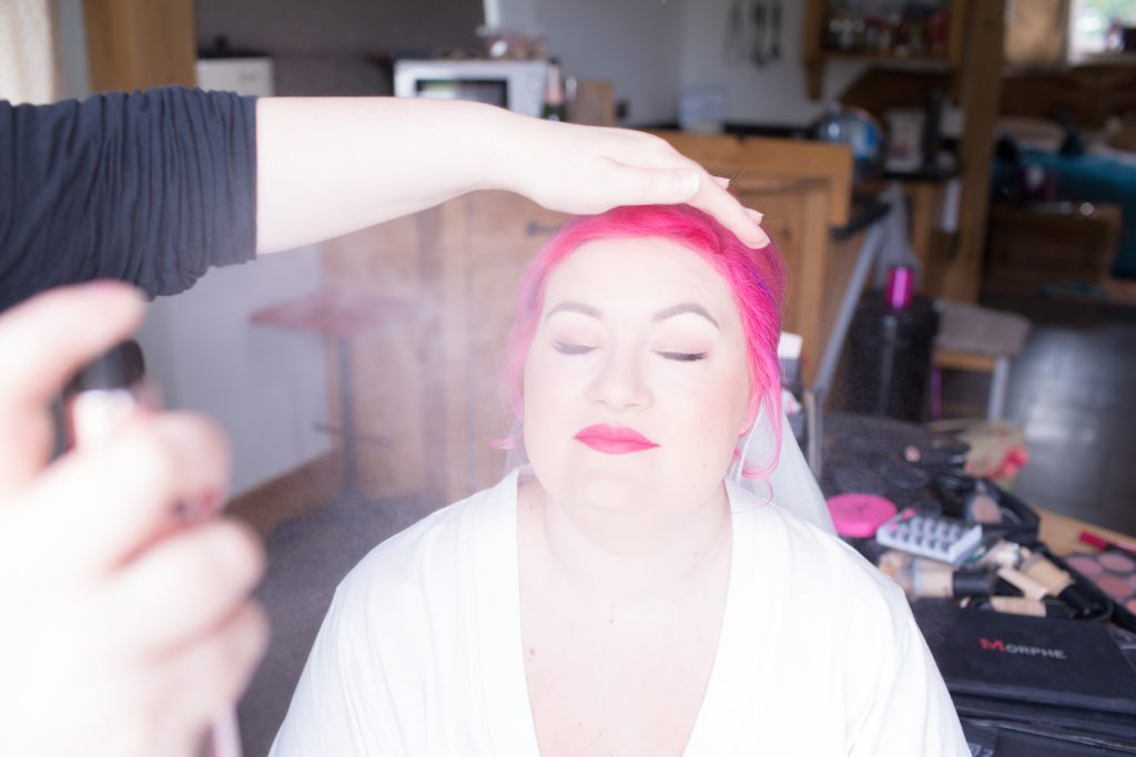 bride being sprayed with hairspray