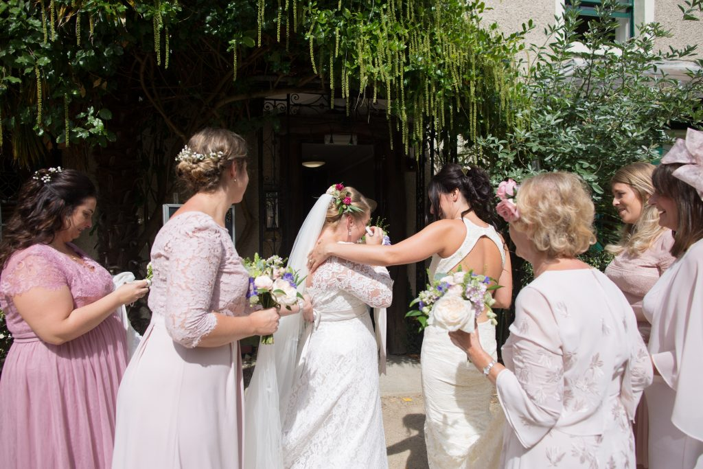 two brides see each other for the first time on their wedding day