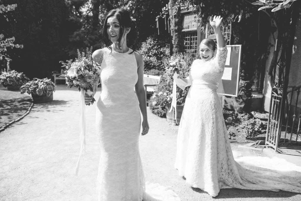 black and white photo of two newly wed brides