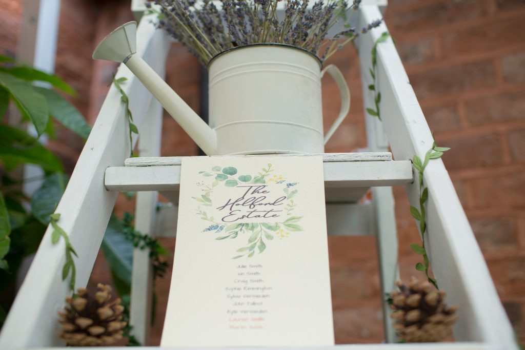 rustic table seating plan on step ladders