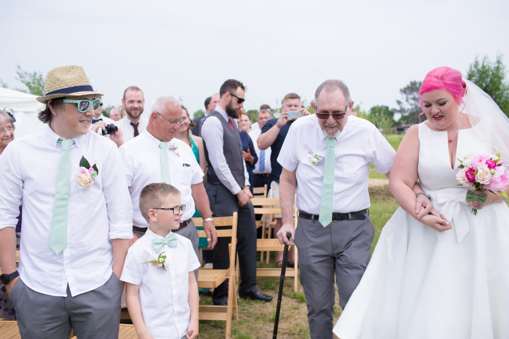 father of bride walking daughter down aisle