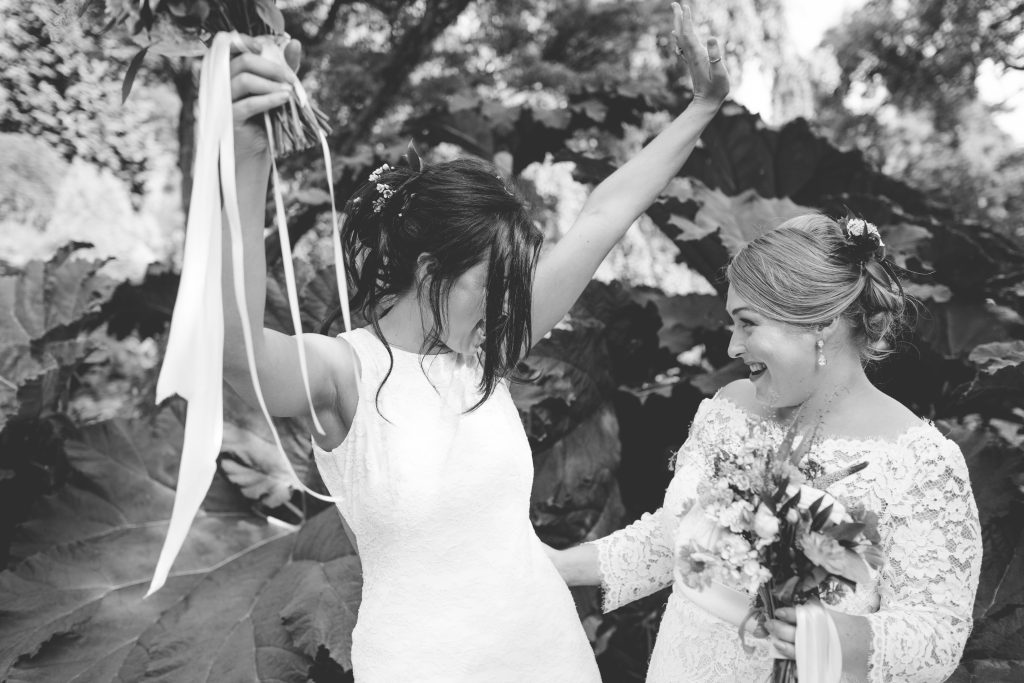 black and white photo of two happy brides