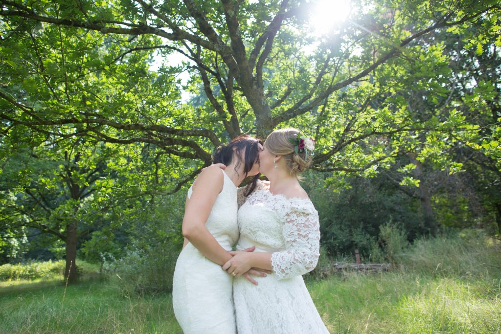two newly wed brides kissing