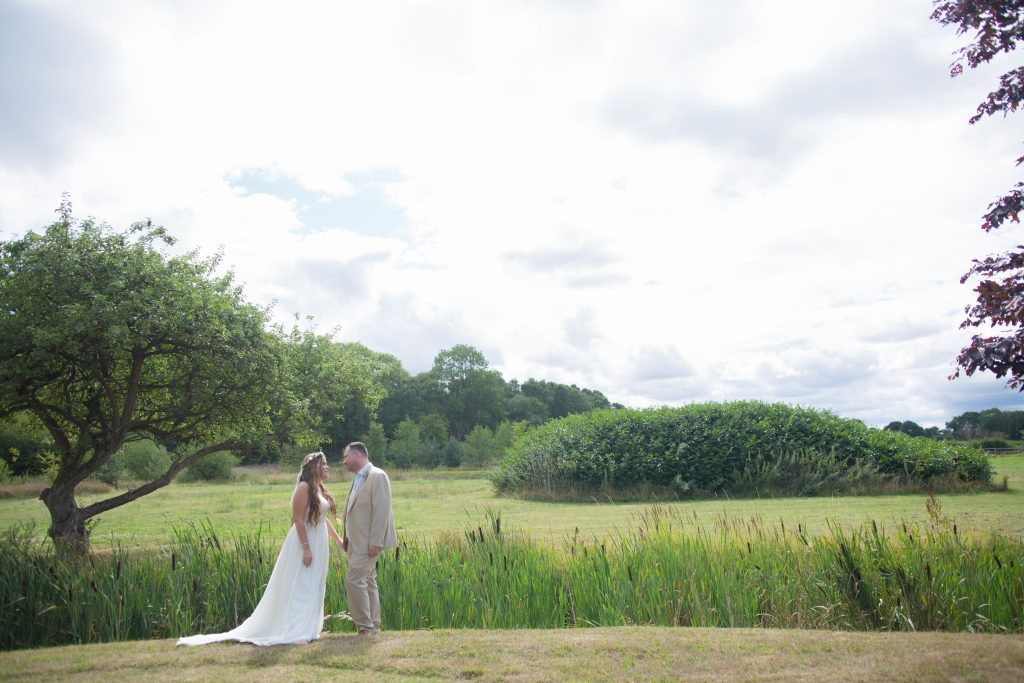 bride and groom stood in field