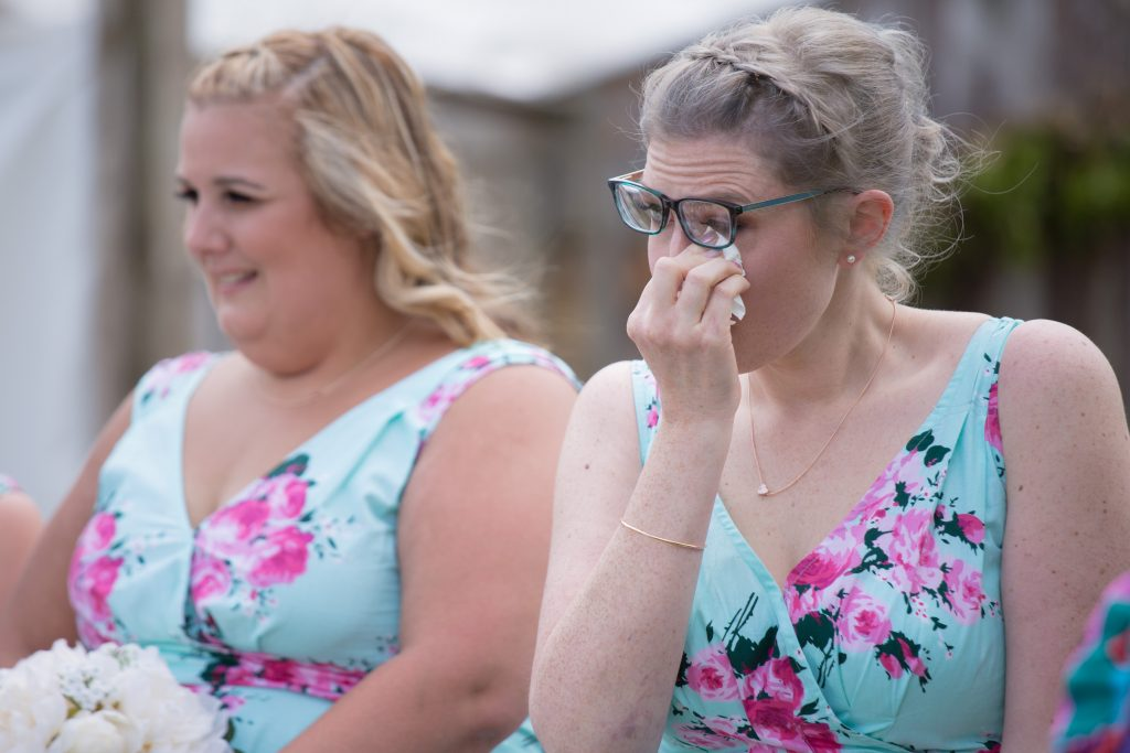 brides sister crying during wedding ceremony