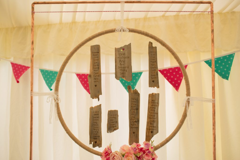 copper and wood wedding seating plan