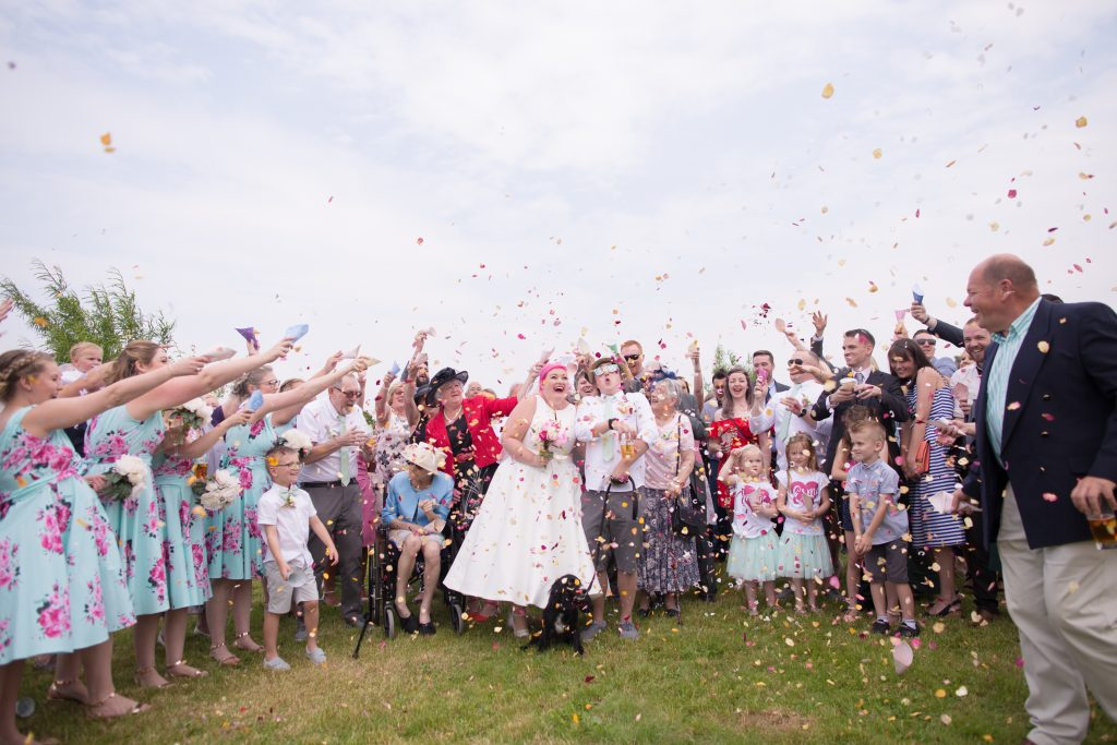 confetti being thrown at wedding at kings acre
