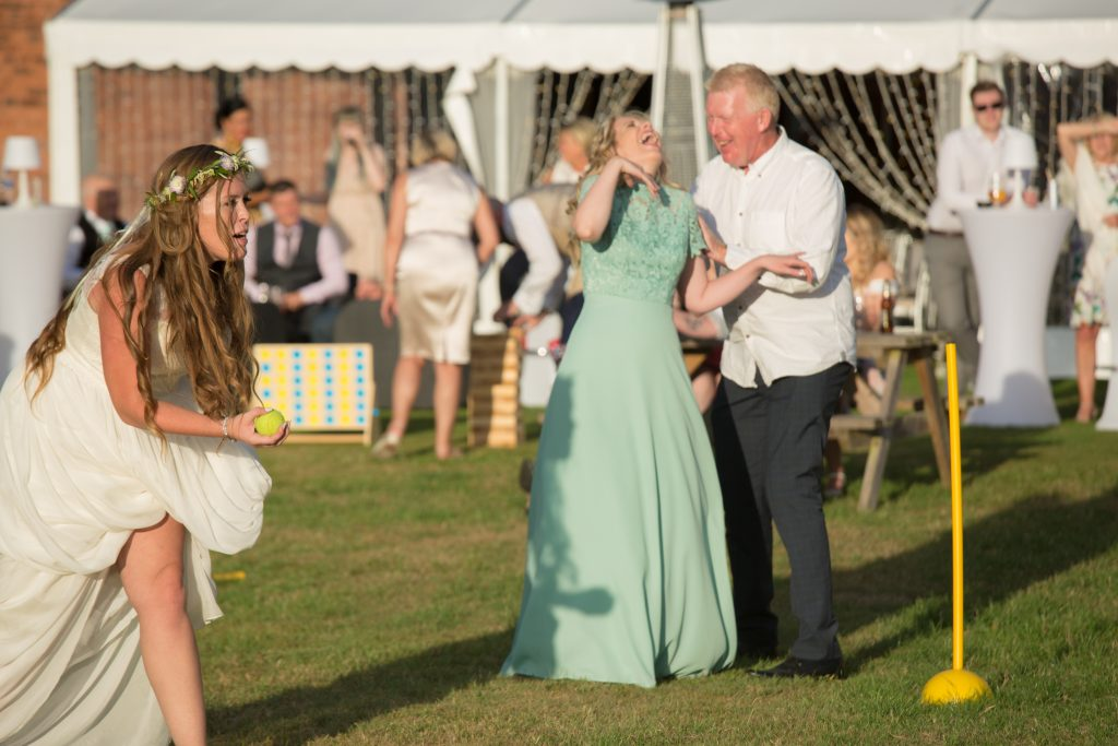 bridesmaid laughing with father of bride