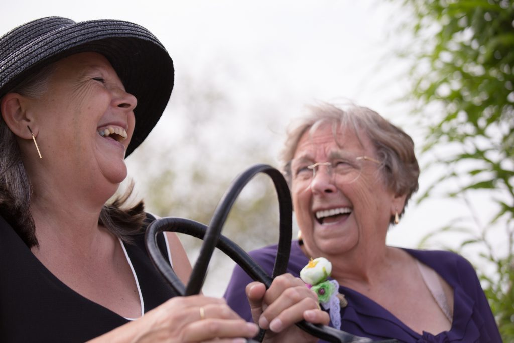two wedding guests laughing at kings acre