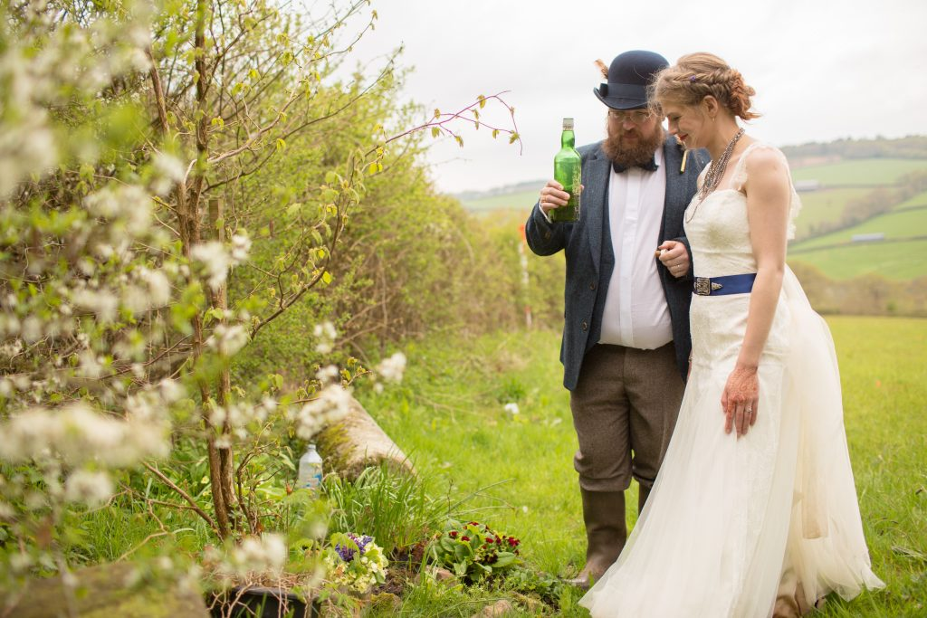 newly married couple toasting with bottle of drink