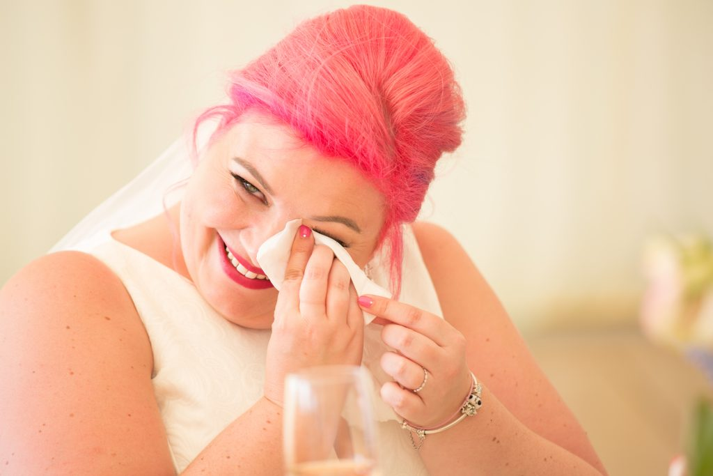 bride crying during wedding speeches
