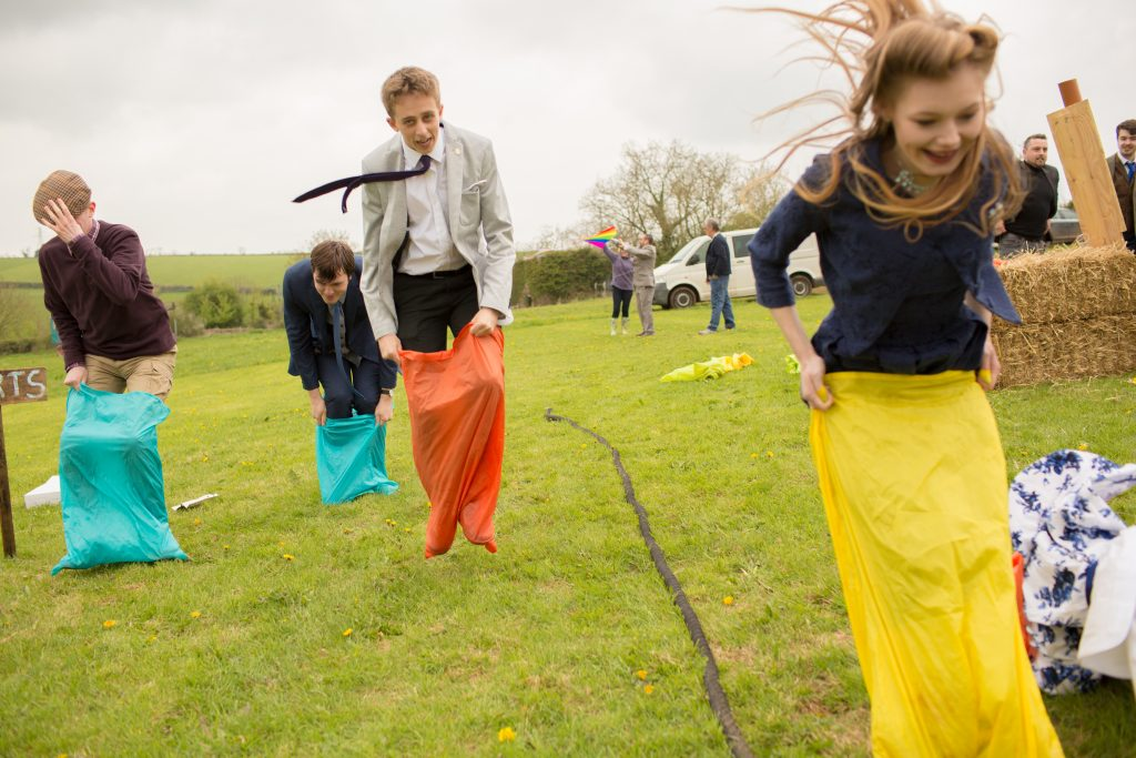 sack race at tipi wedding in Devon