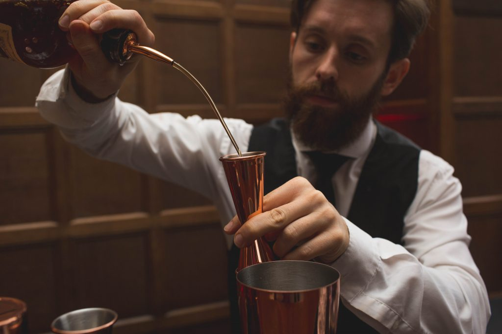 barman mixing a cocktail