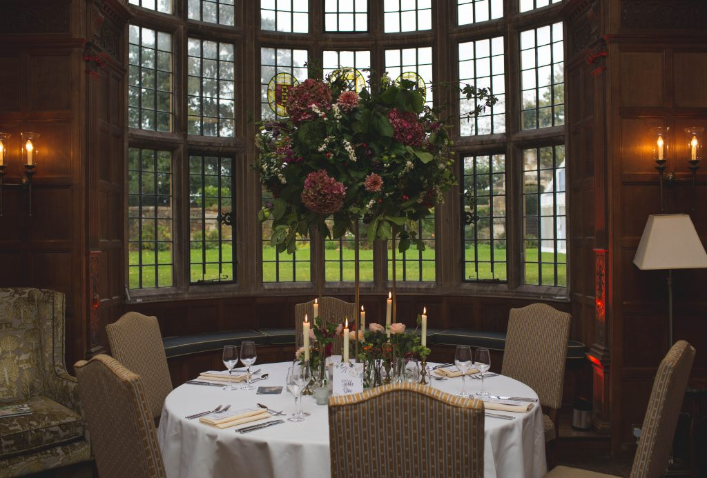 table for wedding set up with large flower centre piece