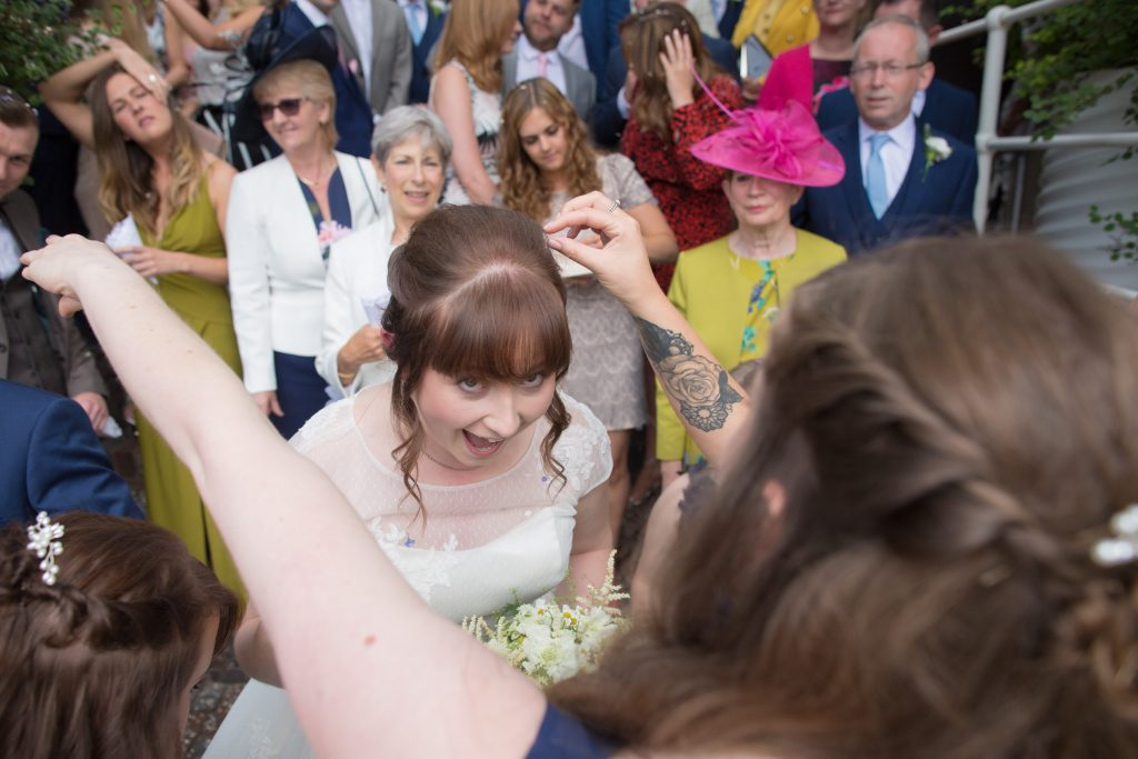 bride having confetti picked out of hair