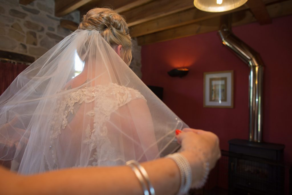 bride having veil attached