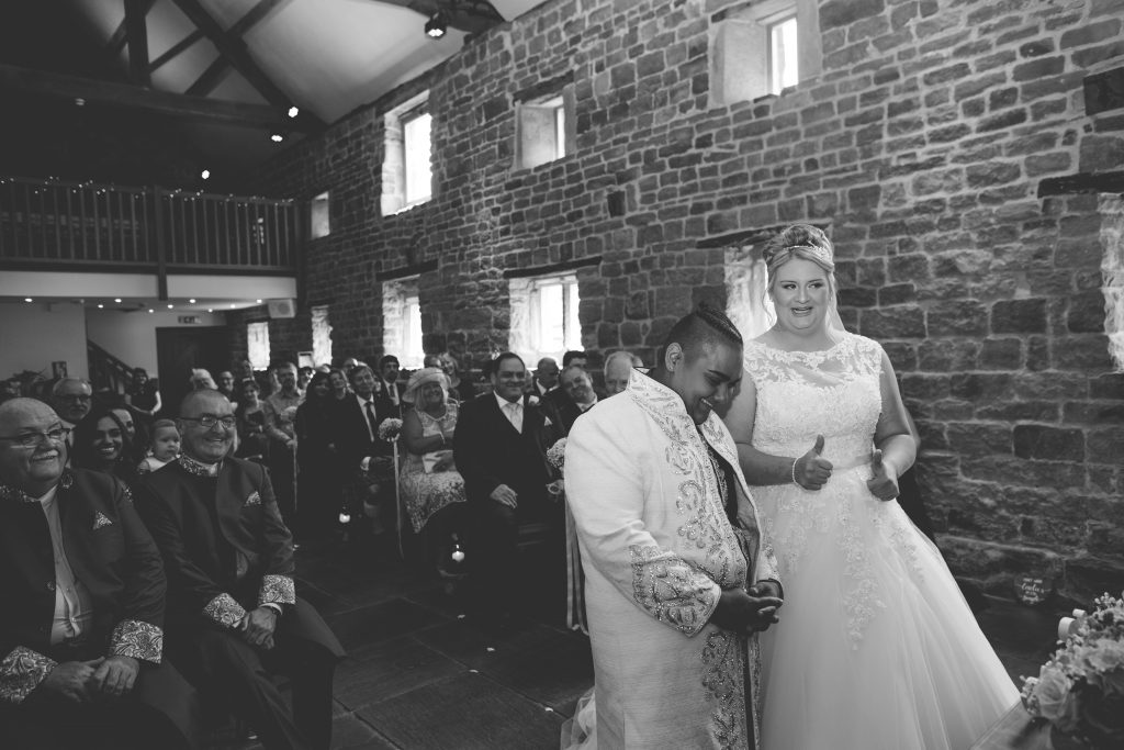 black and white photo of two brides at The Ashes