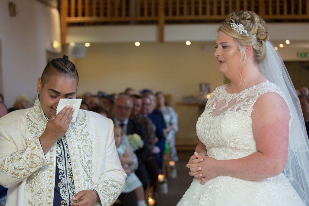 bride wiping tears from eyes