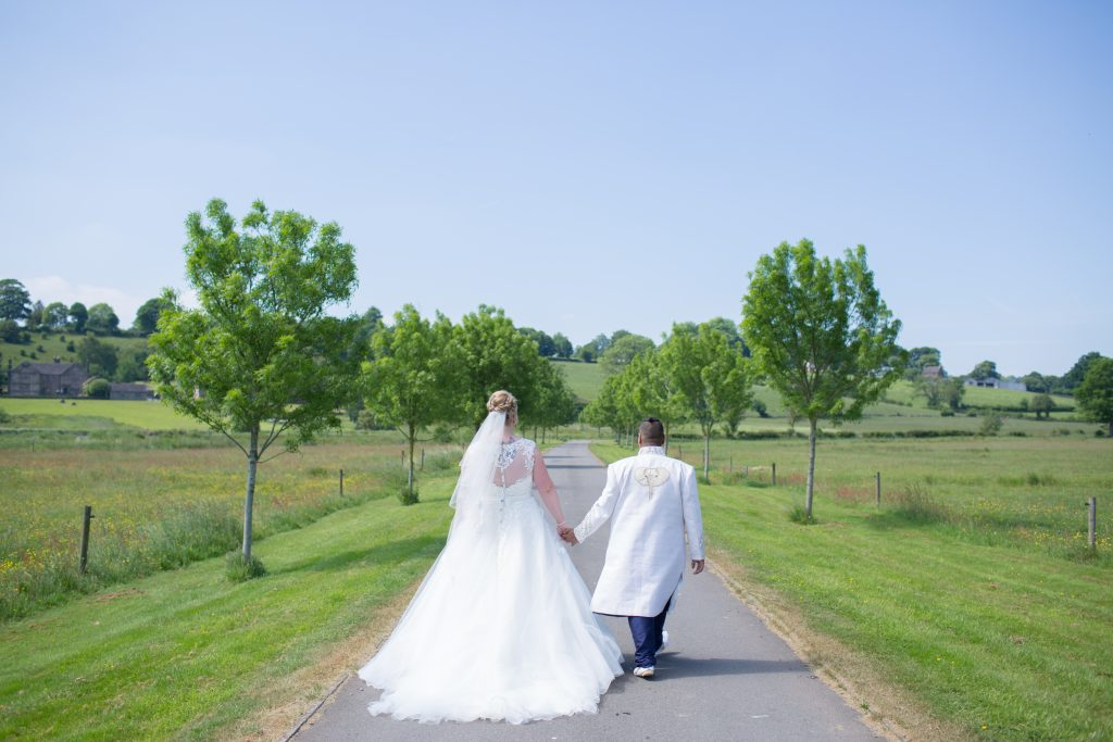 Two brides walking up to The Ashes