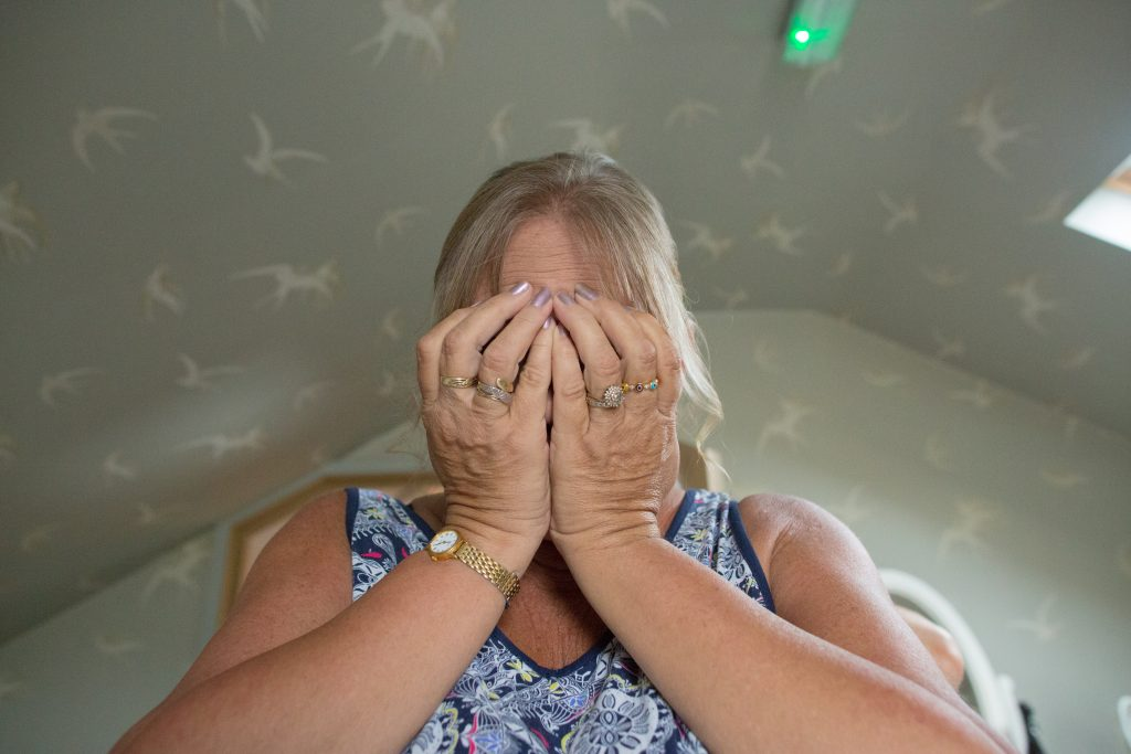 brides mum with hands in front of her face