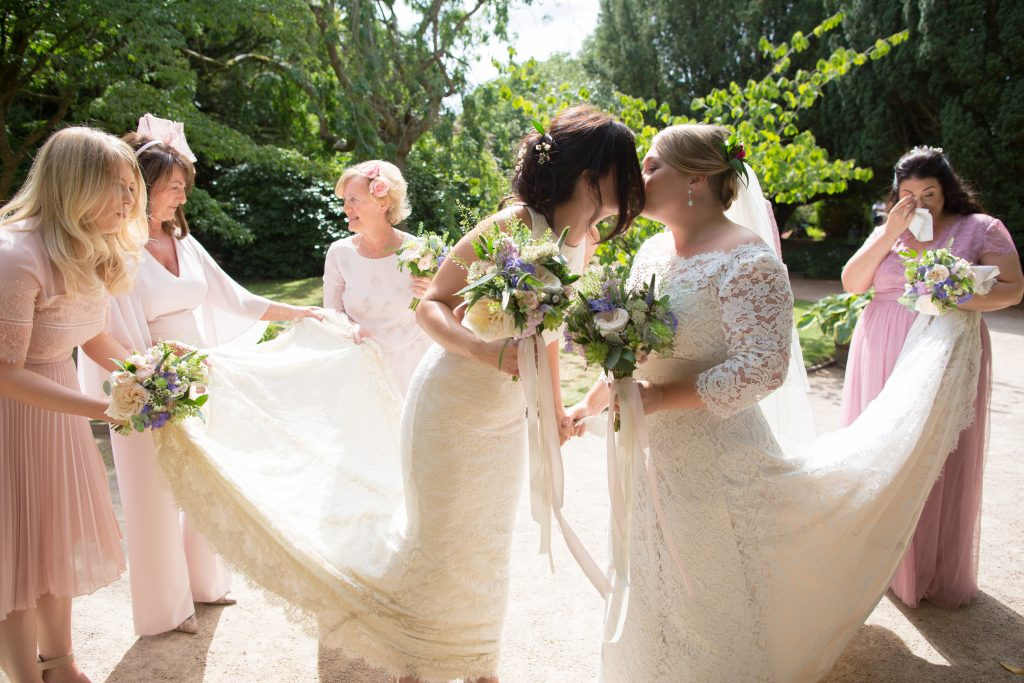 two brides kiss before wedding ceremony