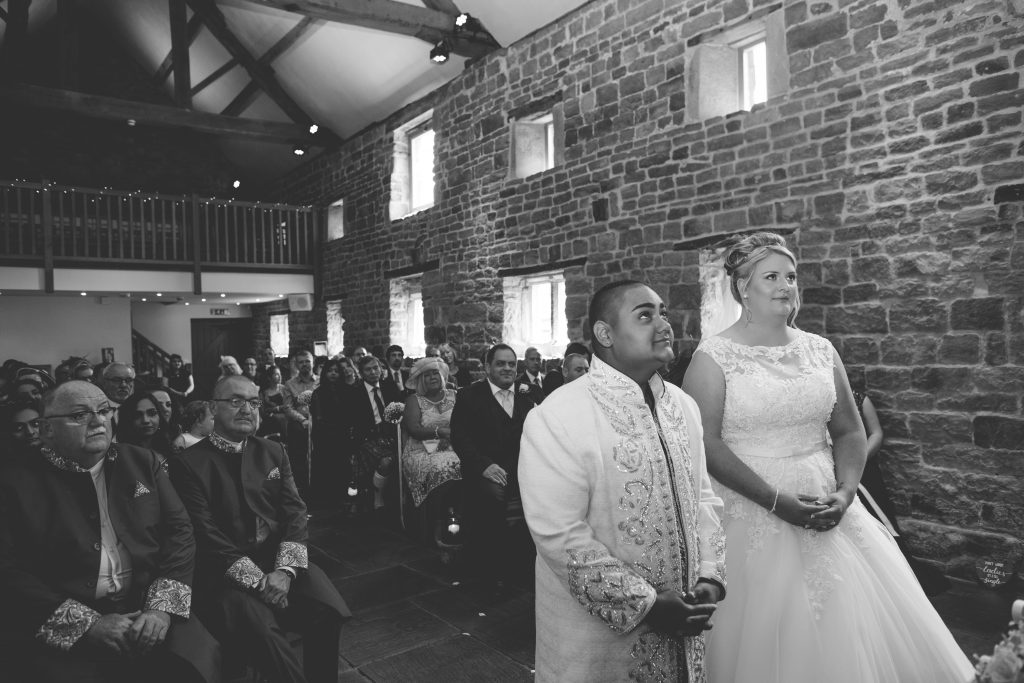 black and white photo of two brides during wedding ceremony