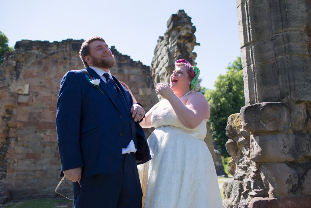 alternative bride and groom laughing