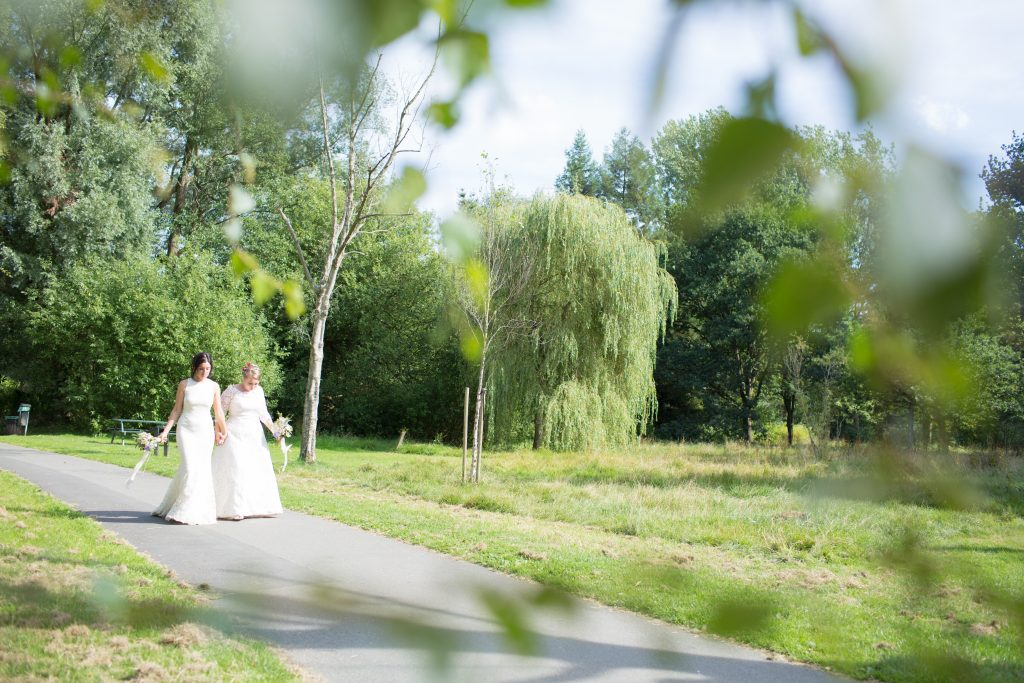 two brides walking along after civil ceremony