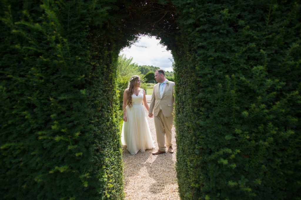 photo of bride and groom taken through archway