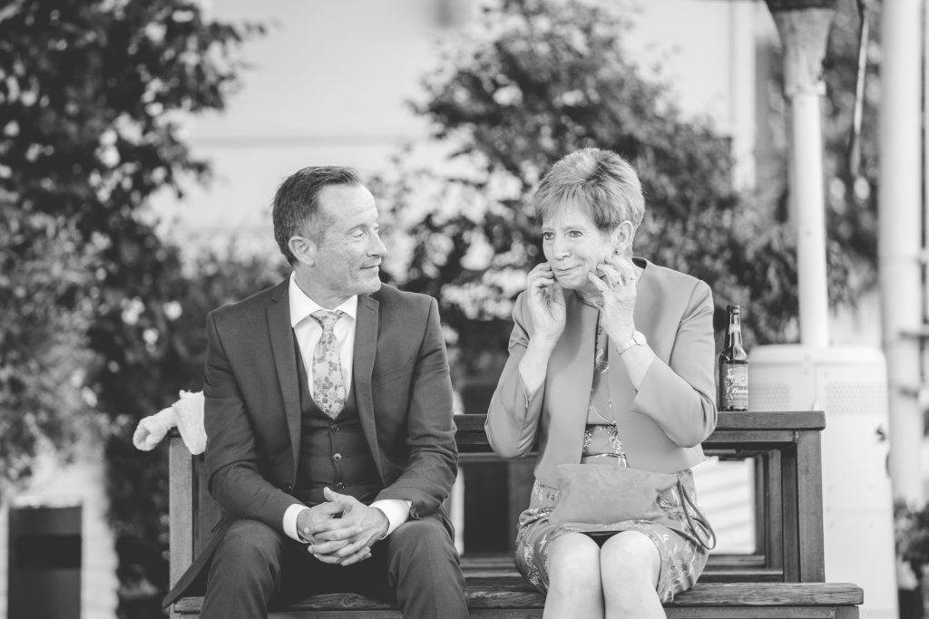black and white photo of brides mum pulling funny face