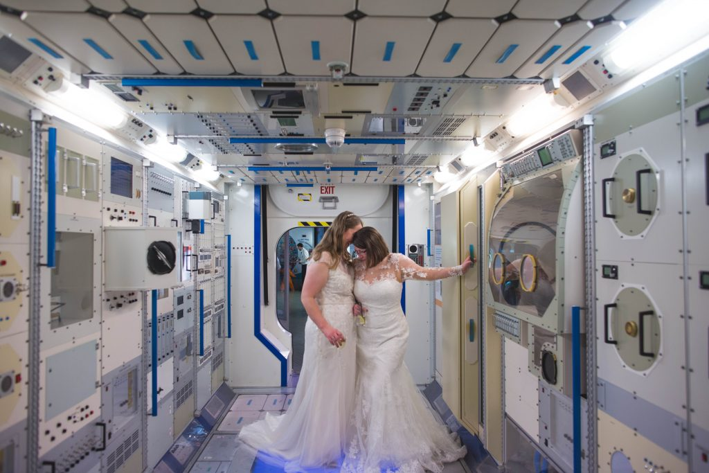 two brides in wedding dresses at the national space centre6