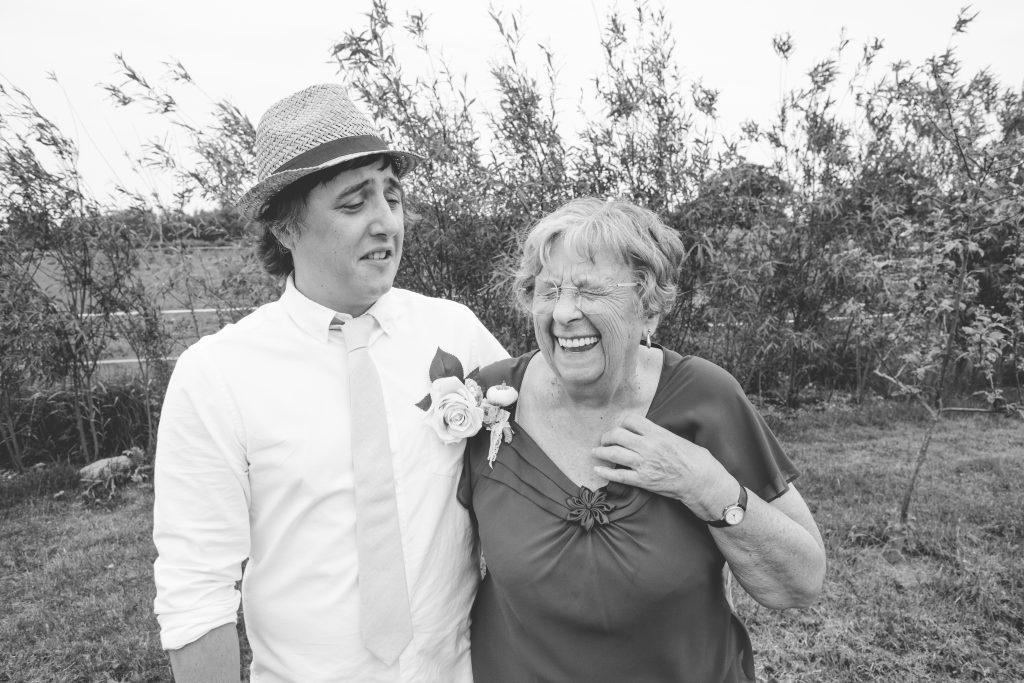 black and white photo of groom with his nan laughing